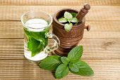 picture of mint leaf  - Mint tea with fresh mint leaves on a wooden background - JPG
