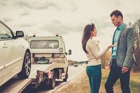 picture of towing  - Couple near tow - JPG