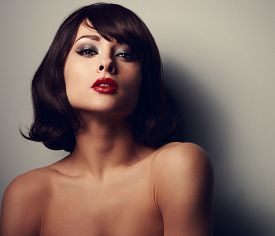 picture of lip  - Sexy hot makeup woman with black hair style and red lips posing on dark shadows background - JPG