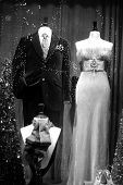 picture of black tie  - a man and womans formal outfits in black and white with a display of neckties - JPG