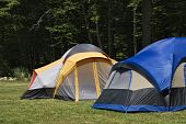 image of tarp  - two camping tents in the mountains already set up for use.