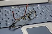Glasses On Keyboard poster