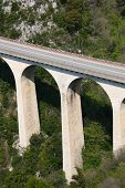image of skyway bridge  - Bridge in the mountains near Eze Village a little ancient village in France in Alpes Maritimes - JPG