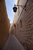 foto of olden days  - Old narrow town street of mediterranean town  - JPG
