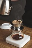 Постер, плакат: Close Up Of Preparing Filtered Coffee In Drip Machine