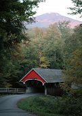 stock photo of covered bridge  - a covered bridge in new hampshire mount jefferson in the background - JPG