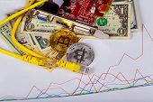 Golden Bitcoin Coins On A Paper Dollars Money Virtual Currency. poster