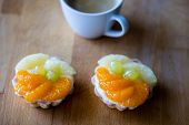 Tasty Muffin With Fruit On A Wooden Table. Hot Tasty Coffee In A Cup. poster