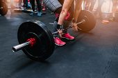 Woman Preparing To Barbell Deadlift poster