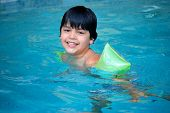 stock photo of floaties  - A four year old boy enjoys the pool - JPG