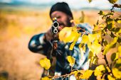 Hunter Aiming Rifle In Forest. Autumn Hunting Season. Hunter With Shotgun Gun On Hunt. Track Down poster