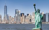 Statue of Liberty with Manhattan downtown  Skylines building in background, New York City , NYC USA. poster