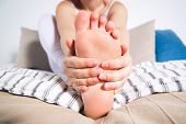 Womans Leg Hurts, Pain In The Foot, Massage Of Female Feet poster