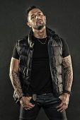 Man Brutal Unshaven Hispanic Appearance Tattooed Arms. Bearded Man Posing With Tattoos. Brutal Stric poster
