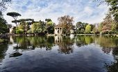stock photo of neo-classic  - Temple of Esculapio located at the beautiful park of villa borghese Rome Italy - JPG