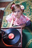 Girl in pink  with a gramophone