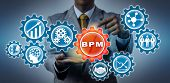 Unrecognizable Businessman Is Highlighting A Bpm Application Icon In A Virtual Gear Train. Concept F poster