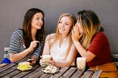 Woman Whispering Secret At Companions Ear, Gossip Together. Female Friends Sharing Time Together Lau poster