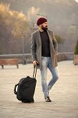 Ready To Travel. Carry Travel Bag. Business Trip. Man Bearded Hipster Travel With Big Luggage Bag On poster