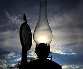 Old Kerosene Lamp Burning With Bright Sun Flame, Oil Lantern It Has Glass Chimney. Kerosene Lamp Con poster