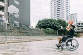 Handicapped Man In Wheelchair Playing Basketball Alone, Concept Of Adaptive Sports And Physical Acti poster