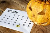 Halloween Concept. October Calendar With Halloween Day Highlighted And Pumpkin - Jack-o-lantern poster