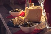 Wooden Table With Parmesan Cheese And Olives Food. Healthy Food. Catering Food. Plate Of Parmesan An poster