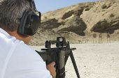 picture of shooting-range  - Closeup of a man in shooting position on shooting range - JPG