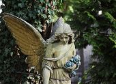 picture of sad christmas  - Figure of angel as a symbol of love kindness and suffering - JPG