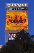The Mirage Hotel Sign With The Beatles Love In Las Vegas, Nv On June 05, 2013