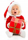 stock photo of child missing  - Young female Santa with a Christmas gift   - JPG
