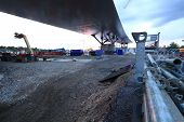 pic of flatboat  - Under the bridge in sunset