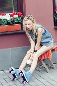 picture of roller-derby  - Young pretty blonde woman sitting on the chair - JPG