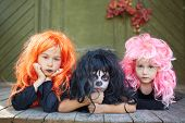 Portrait of three Halloween girls looking at camera