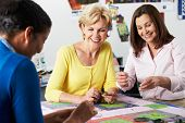 stock photo of quilt  - Group Of Women Making Quilt Together - JPG
