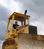 Worker Driving Bulldozer