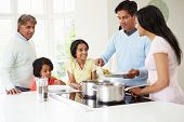 image of saucepan  - Multi Generation Indian Family Cooking Meal At Home - JPG