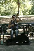 Unidentified guitar player performing in Central Park