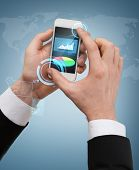 business, internet and technology concept - businessman touching screen of smartphone with chart and