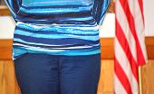 image of citizenship  - Female immigrant attending ceremony to gain usa citizenship - JPG