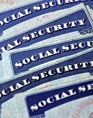 picture of social-security  - Closeup detail of several Social Security Cards representing finances and retirement - JPG