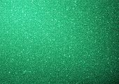 Green sparkle glitter background.
