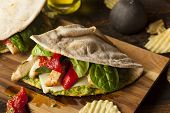 stock photo of sandwich wrap  - Healthy Grilled Chicken Pesto Flatbread Sandwich with Peppers and Spinach - JPG