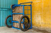 stock photo of tricycle  - Vietnamese delivery tricycle at old apartment in Saigon - JPG