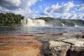 picture of canaima  - waterfall and a lake in front with massive rocks on a beach in venezuela - JPG