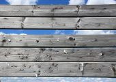 foto of staples  - Dashboard of worn planks with rusty staples - JPG