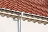pic of downspouts  - Rain gutter and downspout on the wall of a house - JPG