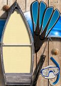 stock photo of spearfishing  - Small wooden row boat with empty yellow paper inside on wooden wall with equipment for spearfishing seashells and blue waves - JPG