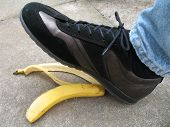 foto of slip hazard  - foot about to tred on banana skin on pavement  - JPG