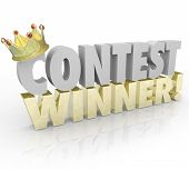stock photo of prize  - Contest Winner in 3d Words and Gold Crown on the letter C to illustrate a lucky recipient of a prize or jackpot in a raffle or lottery drawing - JPG